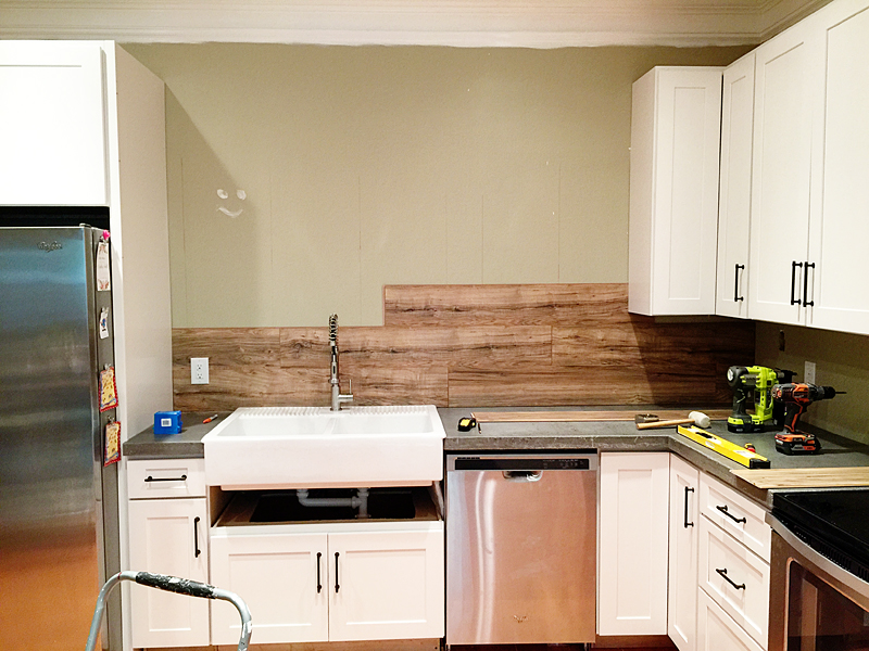 laminate flooring backsplash (it looks like wood!) - bower power