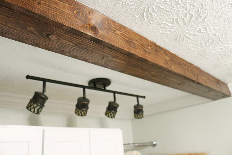How to diy a faux wooden ceiling beam bower power for How to add beams to a ceiling